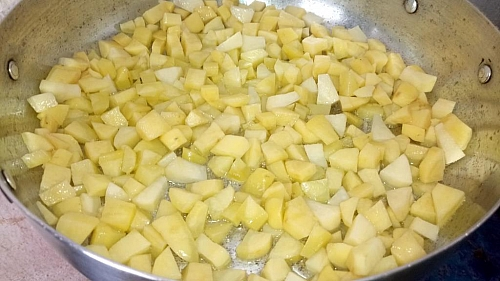 Make sure the oil is not too much, just enough to cook the potatoes