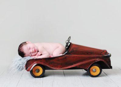 Newborn with Car Prop