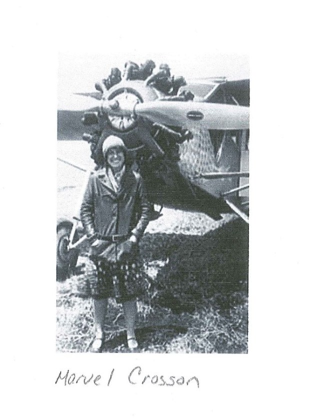 photo scan of Marvel Crosson in her pilot gear standing next to plane
