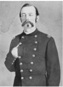 Portrait of William Welsh standing with hand over breast in uniform.