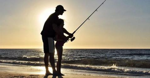 Fishing In The Ocean From Shore