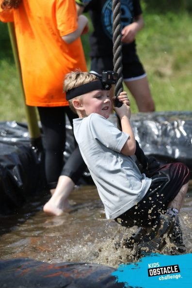 Andrew swinging over the mud pit