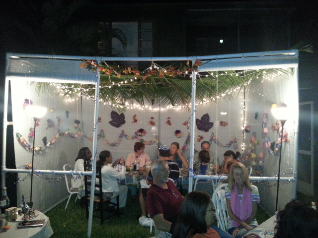 enjoying the evening in and around the sukkah