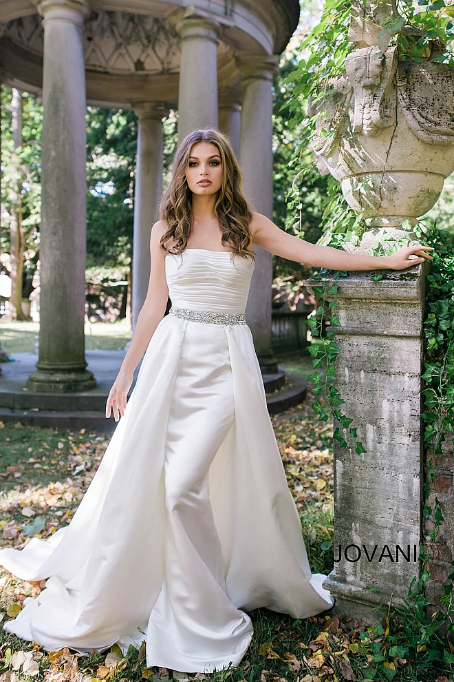 Strapless ruched bodice dress with embellished belt and an over skirt