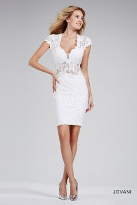 Off-white fitted cocktail dress with sheer plunging neckline.