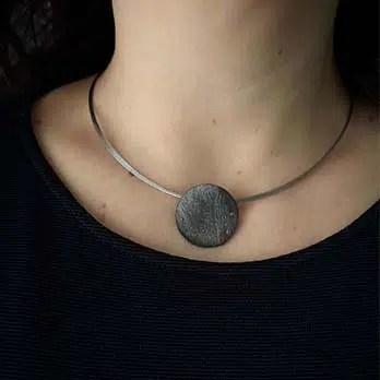 colgante de plata negra eclipse