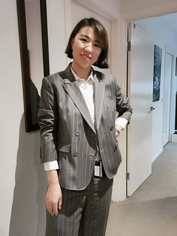 My friend Ming wears a grey suit