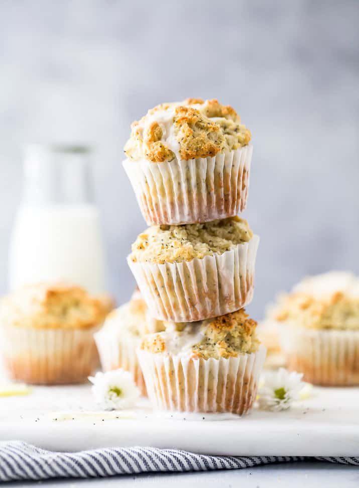 moist gluten free lemon poppyseed muffins piled on top of each other