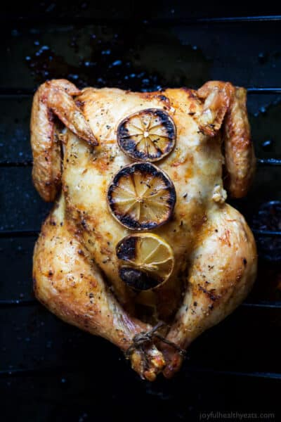 overhead photo of oven roasted chicken with garlic lemon butter sauce