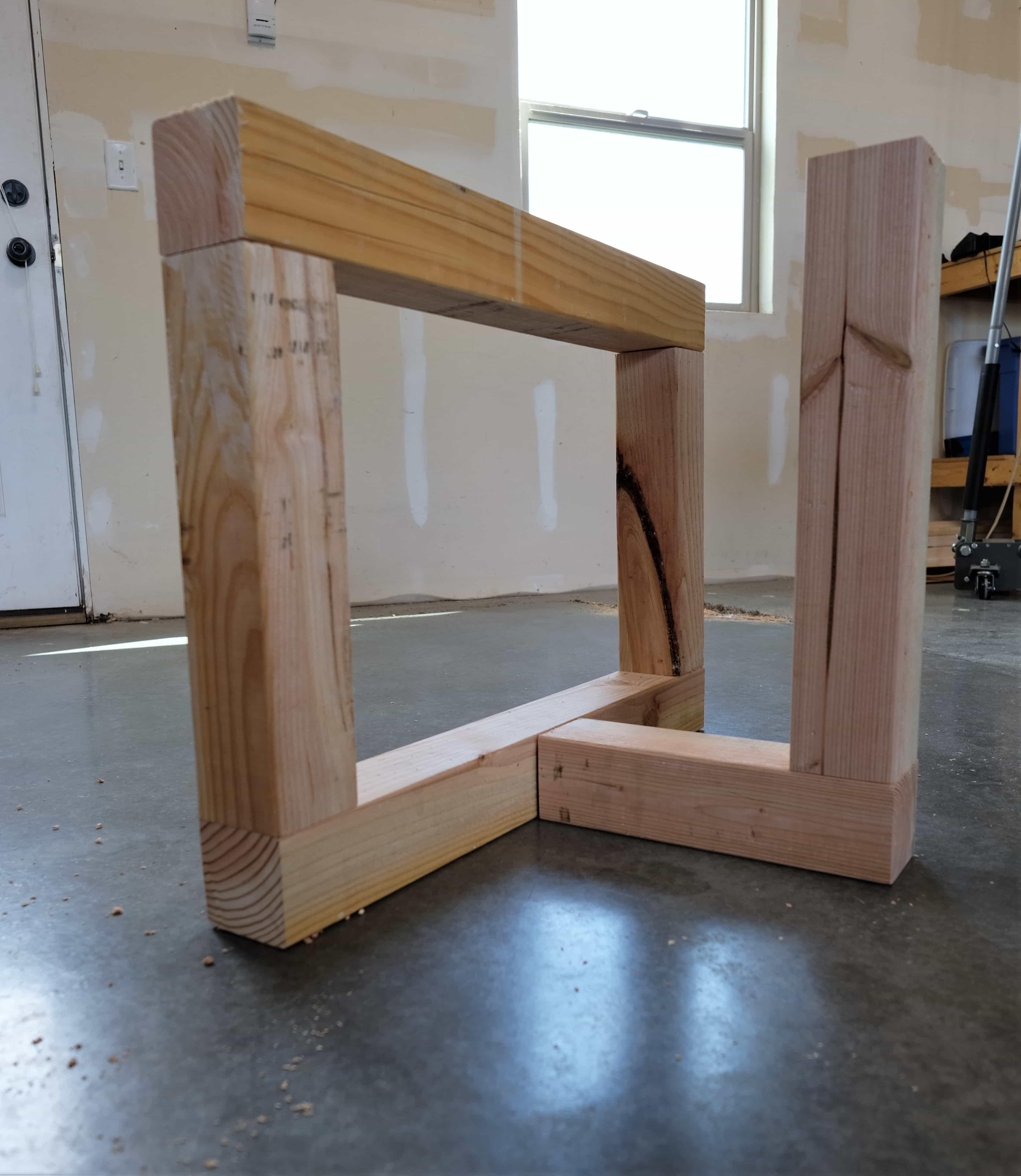 Wood boards being connected while building rustic coffee table