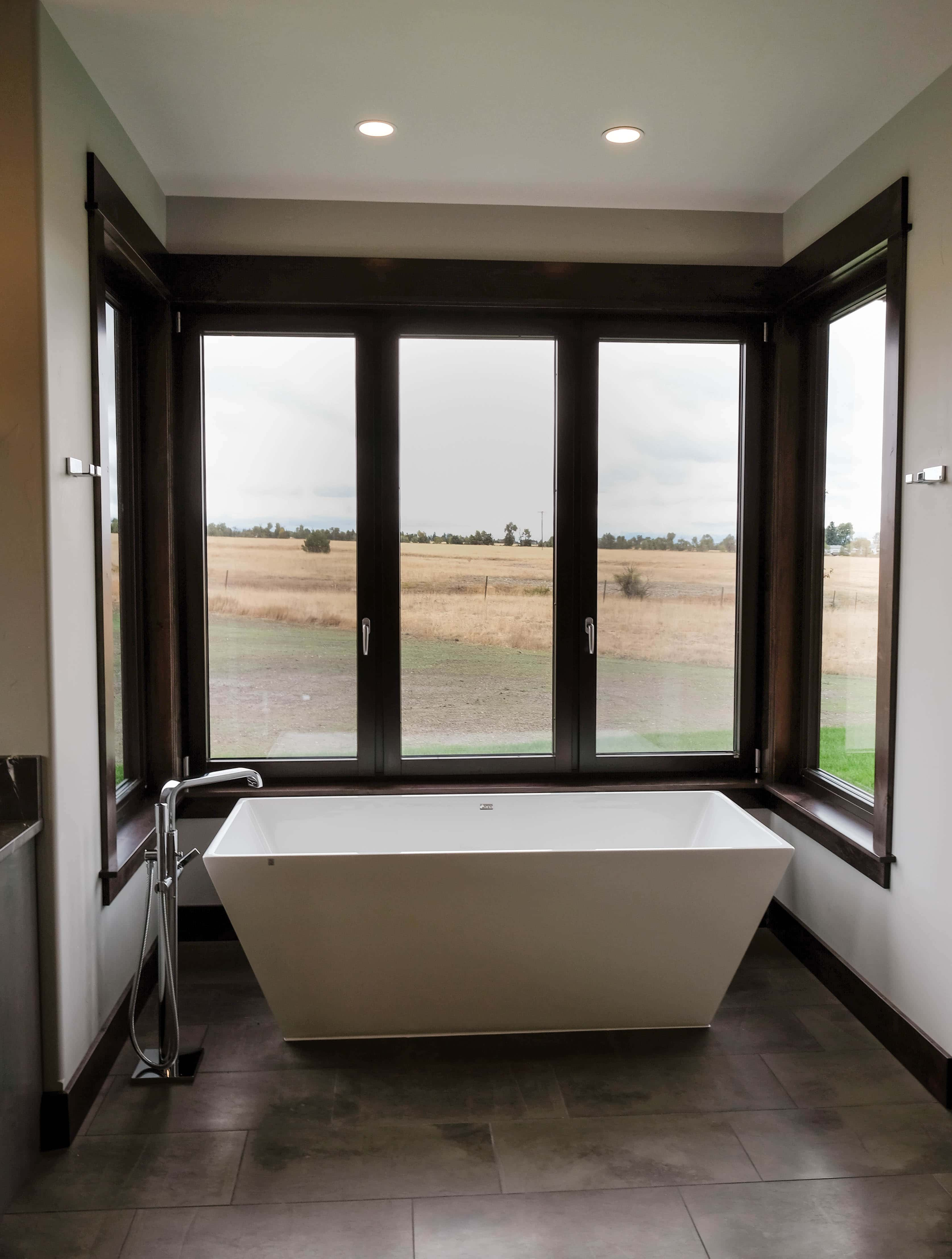 Parade of Homes bathroom with large tub surrounded by windows