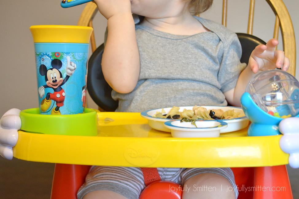 The Mickey Mouse Helping Hands Feeding & Activity Seat is a great and multipurpose booster chair that is great for food and activity!