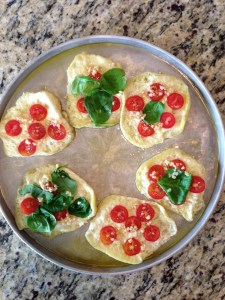 Topped with spinach and sliced cherry tomatoes.