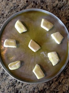 Place frozen yeast rolls in a pan to thaw.