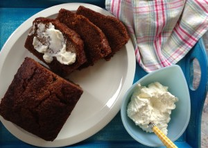 Gingerbread served with a mixture of cream cheese and whipped cream.