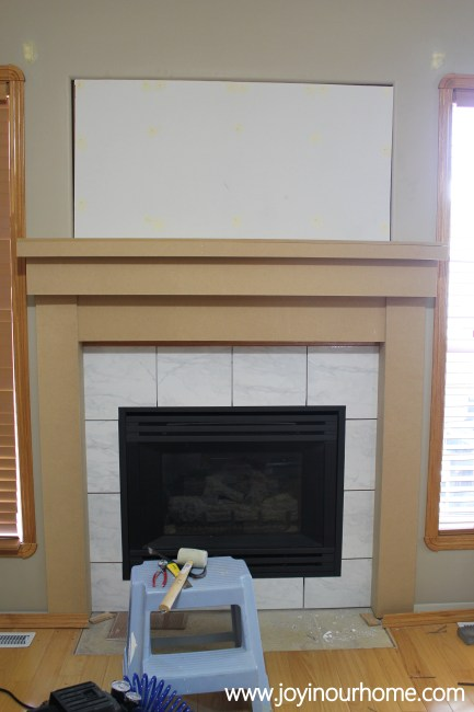 http://www.joyinourhome.com/spray-paint-fireplace-makeover/