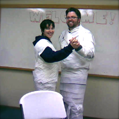 Us wearing toilet paper outfits dancing
