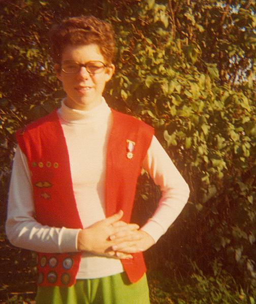 Joy wearing her Cadette Scout badge vest