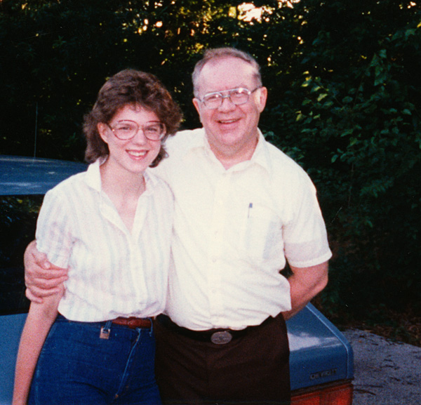 photo of Joy wearing her first wig with Dad