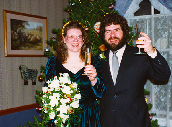 photo of Rick and Joy in front of Christmas tree