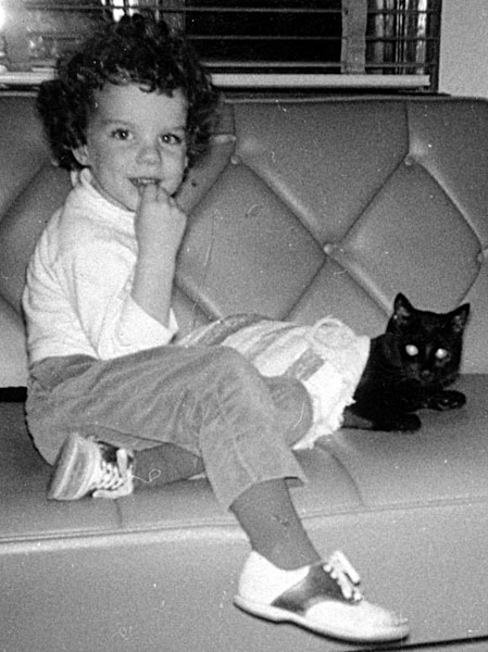 photo of little girl and black cat, circa 1965