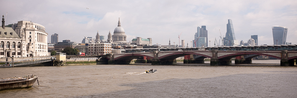 Rick took this photo of Blackfriars Bridge with the London skyline. The building on the right is called the Walkie-Talkie, 20 Fenchurch Street. The angled building is known as the Cheesegrater, actually the Leadenhall Building. The dome is St. Paul's Cathedral. Does anyone know what the rounded building to the left is?