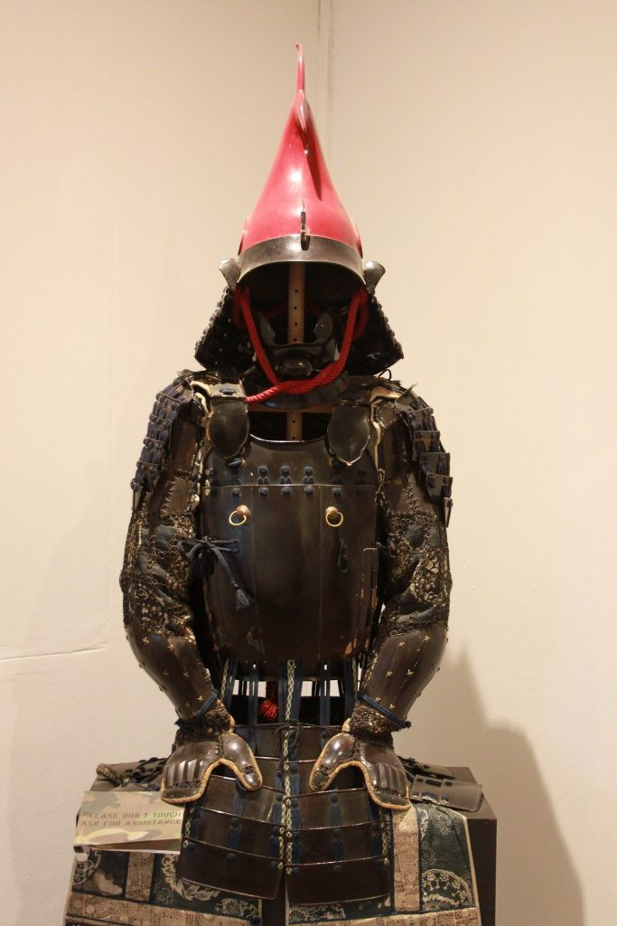 Samurai armour (this artefact originates from a Japanese fishing village - indicated by the red fish on top of the helmet)
