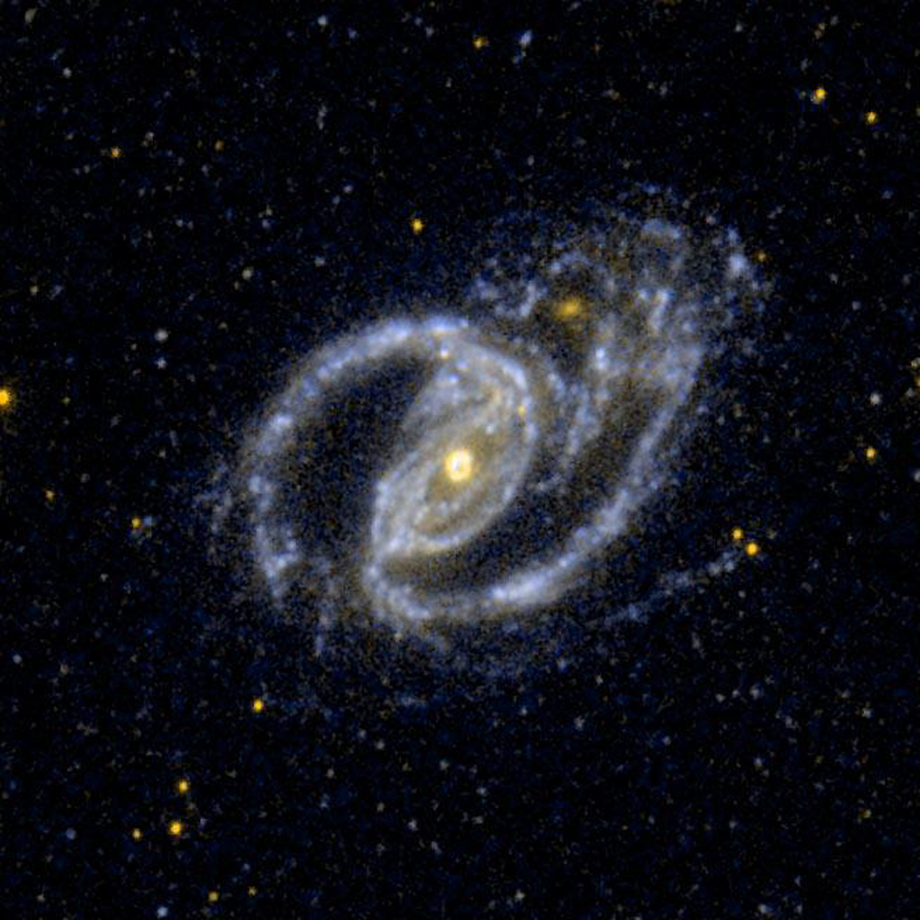 Space Images  A Barred SpiralGalaxy and the Small