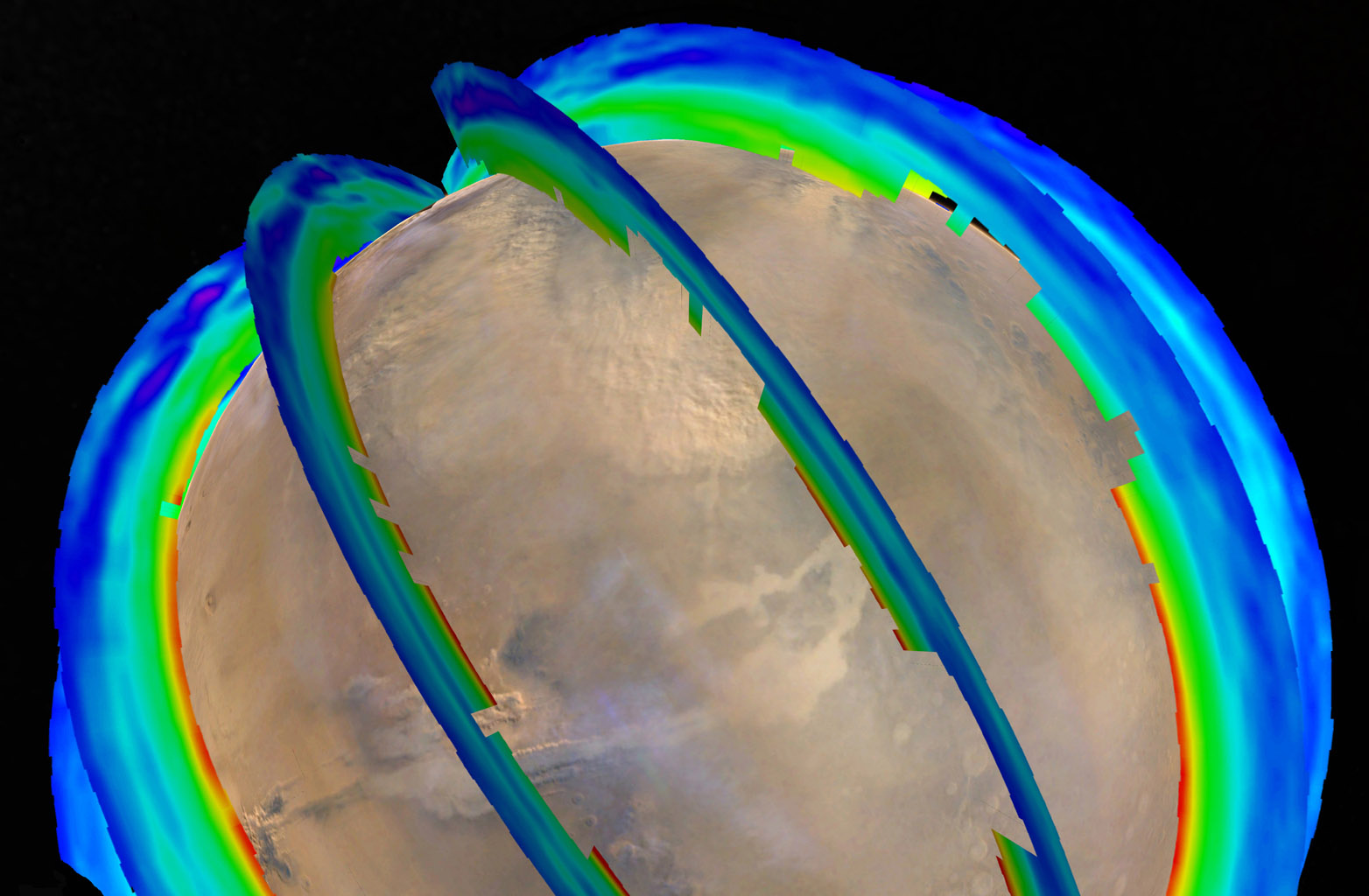 This graphic overlays Martian atmospheric temperature data as curtains over an image of Mars taken during a regional dust storm. The temperature profiles extend from the surface to about 50 miles (80 kilometers) up. Temperatures are color coded, ranging from minus 243 degrees Fahrenheit (minus 153 degrees Celsius) where coded purple to minus 9 F (minus 23 C) where coded red.