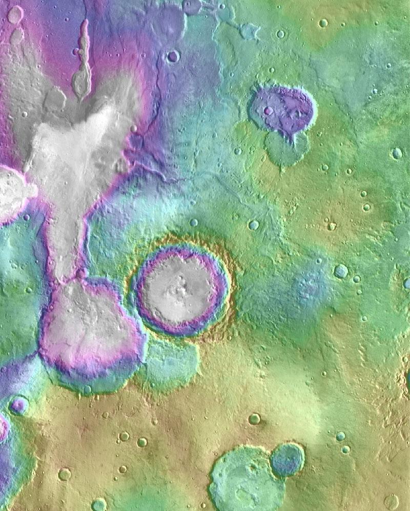 """Paisaje de la región Arabia Terra de Marte, con valles jóvenes. La zona incluye la cuenca apodada """"Lago Corazón"""" arriba a la izquierda. Crédito: NASA/JPL-Caltech/ASU."""