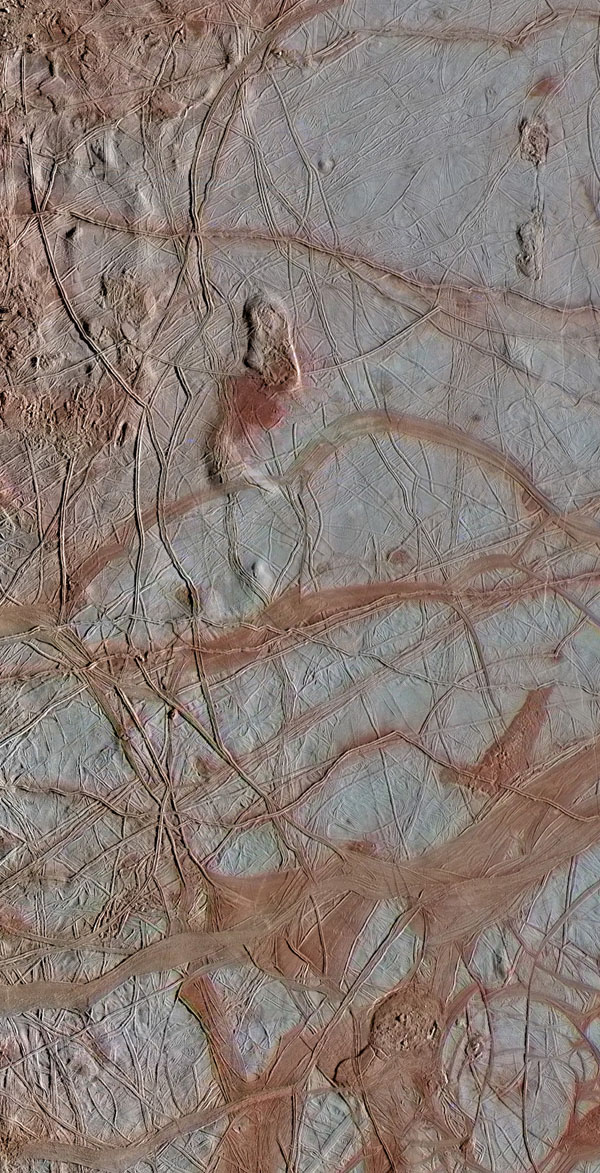 This enhanced-color view from NASA's Galileo spacecraft shows an intricate pattern of linear fractures on the icy surface of Jupiter's moon Europa. Newer fractures crosscut older ones, and several wide, dark bands are visible where the surface has spread apart in the past. The scene also contains several regions of