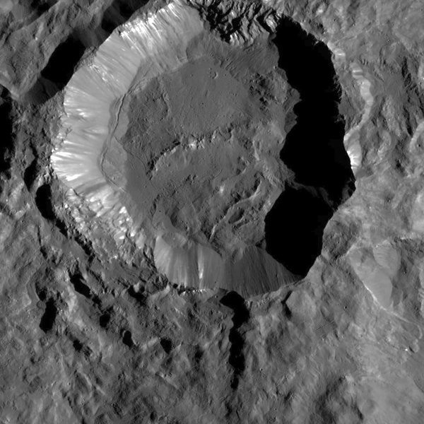 This image from NASA's Dawn spacecraft shows Kupalo Crater, one of the youngest craters on Ceres. The crater has bright material exposed on its rim and walls, which could be salts. Its flat floor likely formed from impact melt and debris.