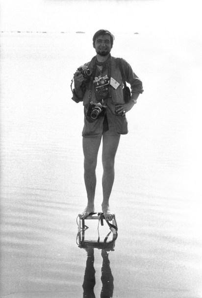 July 16 1969, Cap Kennedy, Florida. It is 9.30 am. JP Laffont on stepladder in middle of a small bay, about 30 feet from shore. On his back, in 2 minutes Apollo XI will depart for the moon. In from of him: thousand of well-wishers and supporters of the 3 astronauts. JP will never see the rocket departure; he photographed the enthusiast crowd reaction. Photo by David Burnett.