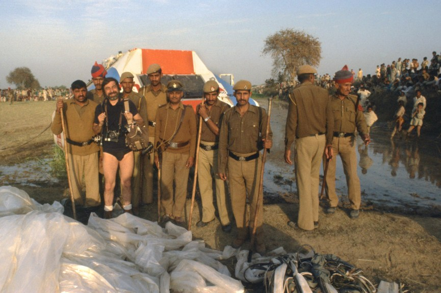 Februray 15 1981, Mirchpur (Haryana), India. The balloonists Maxie Anderson and Don Ida crashed. They left Luxor, Egypt 2 days before. JP Laffont was following the flight around the world. The picture shows JP Laffont who removed his pants full of mud, posing with the local police in charge of keeping the crowd away from the expensive balloon equipment.