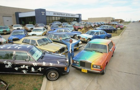 October 3, 1986. Dallas, Texas. JP Laffont outside a car dealer, who is selling all the Rolls Royce that belonged to the leader of the Rajneesh, Krishna Deva.