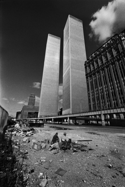 Manhattan, New York City, NY. October, 1975. Two homeless men squat below the recently constructed World Trade Center. New York was bankrupt, in shambles and the building was not occupied.