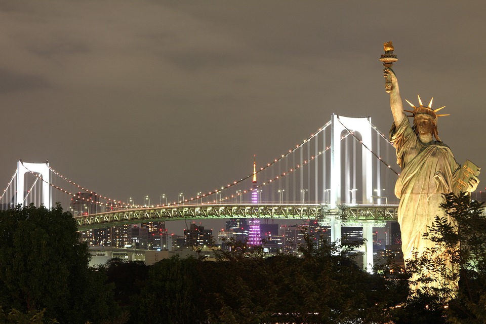 The Statue of Liberty and the Brooklyn Bridge.