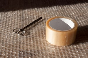 scissors, tape and plastic wrap