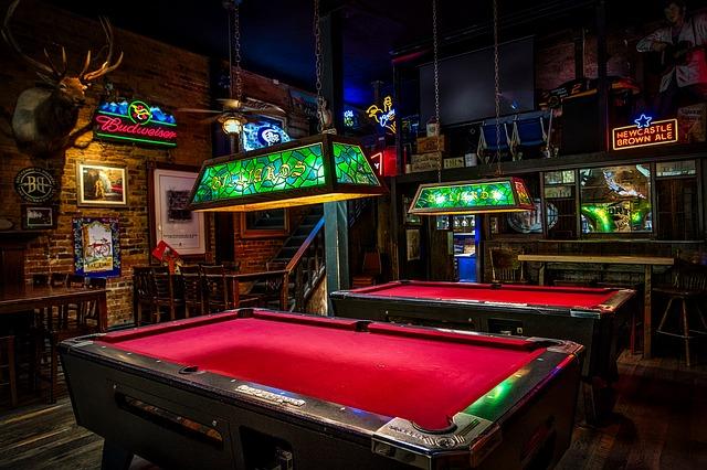 Pool tables at a bar