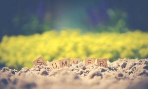 Word 'summer' in letters, in sand