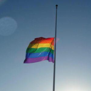 gay flag half mast