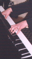 Picture of Ann Hogben's hands playing the piano