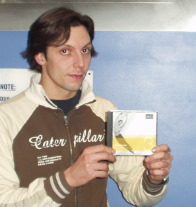 Dan holding a copy of the Studio Series Intuitions CD Vol 3: it's him on the front of the CD.