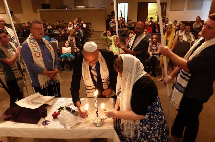 Nicholas Thalasinos renewing his marital vows with his wife at a Jewish-style ceremony, 2013. (Facebook)