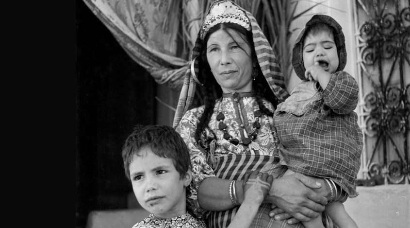 Young children, tired of the stifling atmosphere of the synagogue, come outside to be with their mother in Djerba, Tunisia. January 01, 1950. 850,000 refugees from Tunisia and other Arab countries were expelled after the creation of Israel. (Graphic House/Archive Photos/Getty Images)