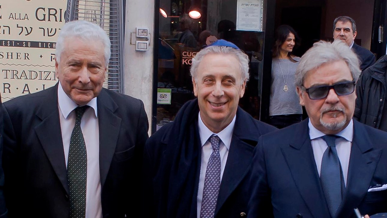 Renzo Gattegna, left, stands outside a kosher restaurant in Rome, Italy on March 9, 2015. (Stefano Montesi - Corbis/Getty Images)