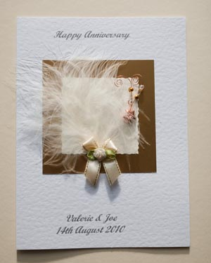 Feathers and Bows Anniversary Card Front - Ref P108