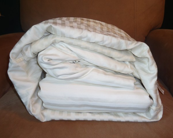 bed sheet storage in the linen closet