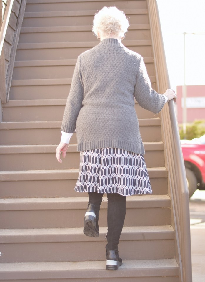 Over the knee boots worn by older women