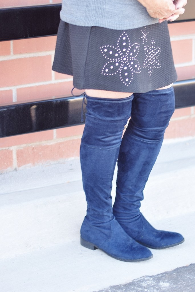 Over the knee boots with a short skirt